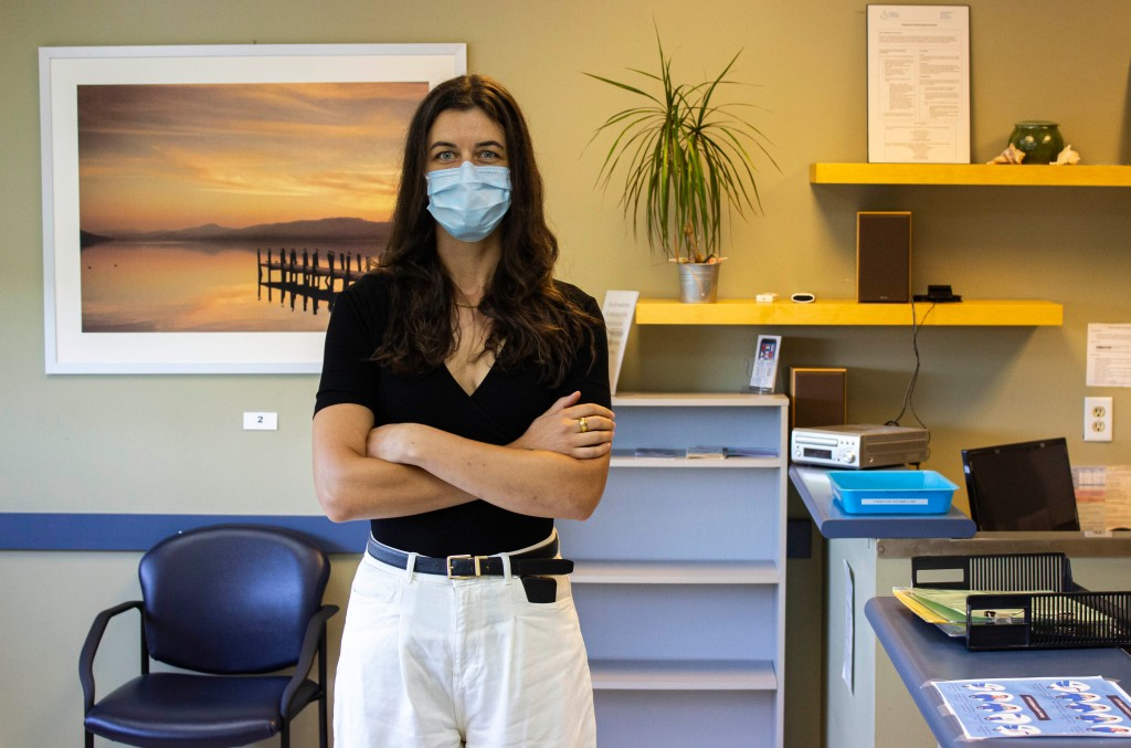 Clare Hacksel stands in the Choice in Health Clinic, where staff have had to adapt to COVID-19